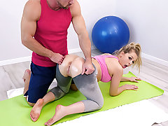 Zoey Monroe loves to exercise and it shows. Here she is doing her floor routine and working up a sweat. Literally. She works out so rock hard she sweats right thru the pubes of her tight, light gray spandex. When her trainer finds her, he paws his arm aga